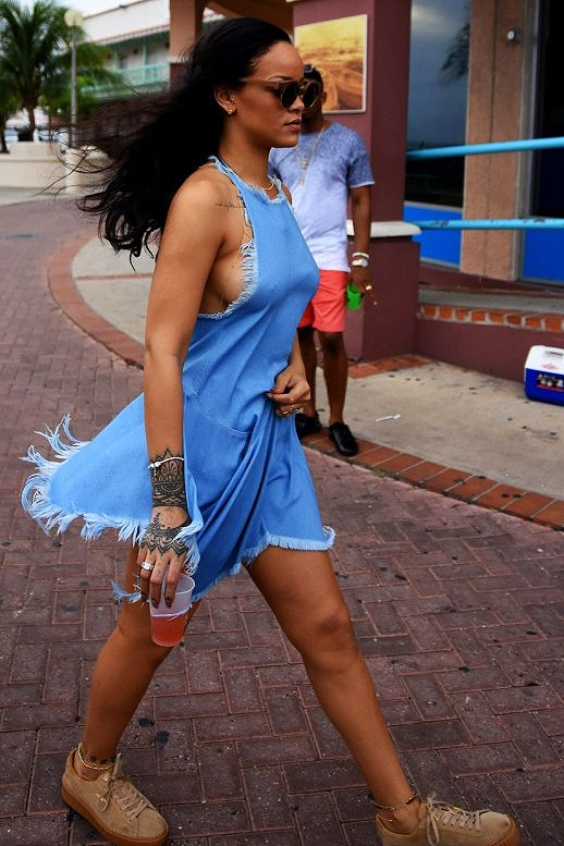 d9e09bb9e9 Rihanna street style in Barbados  ripped denim dress and round sunglasses  outfit