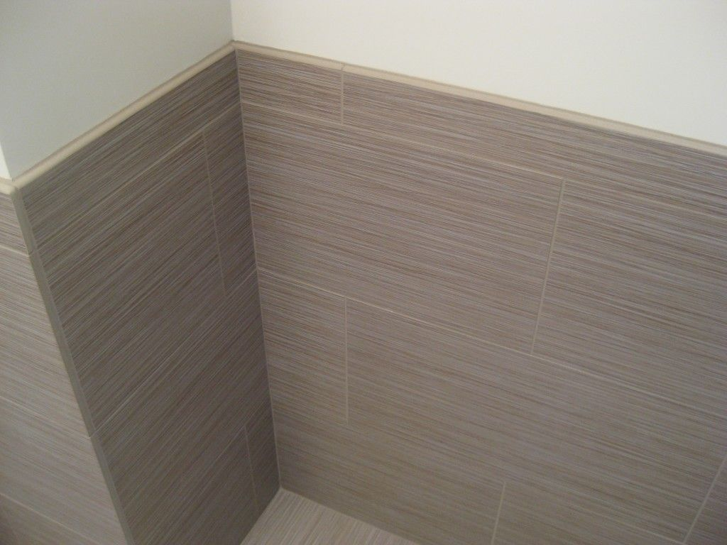 Tile wainscoting, eliminating need for baseboard trim. R&B Bath#2 ...