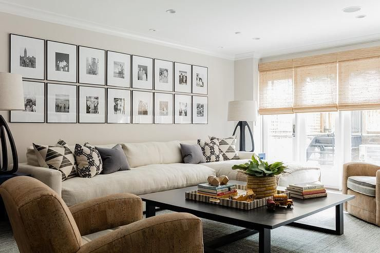 Two Rows Of Framed Black And White Photographs Are Mounted To A