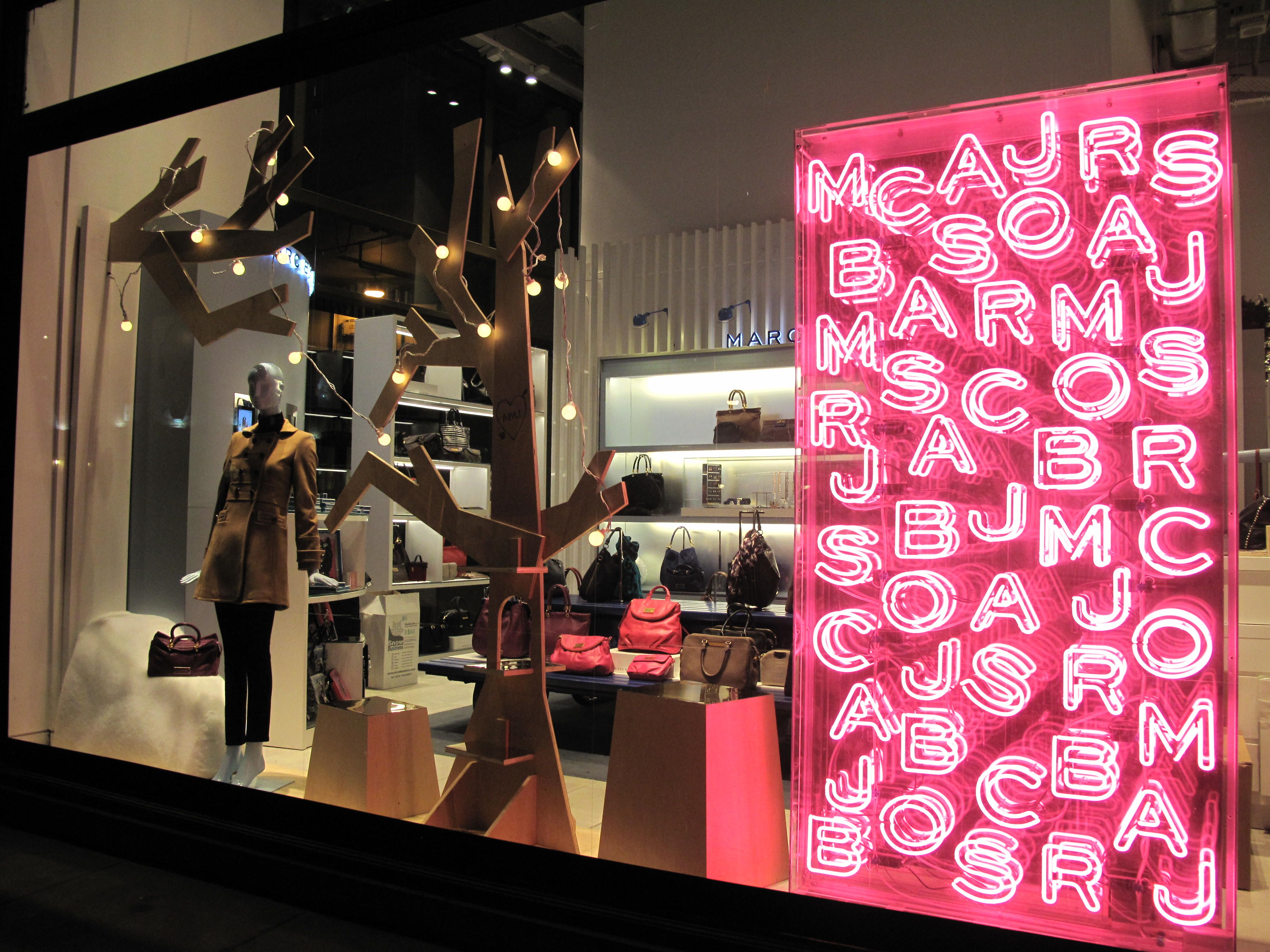 Neon Lights Illuminate this Christmas Window Display by