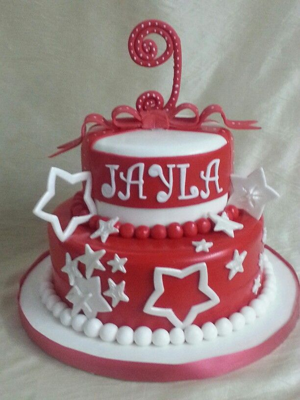 The Cakebox Bahamas: Red and white fondant finished birthday cake with fondant bow and stars.