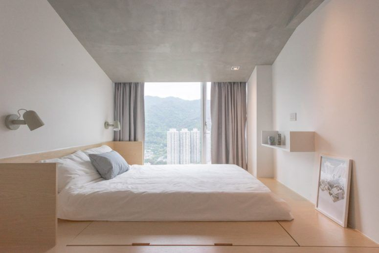 The Master Bedroom Looks Peaceful, With A Concrete Ceiling, Adorable Views  And A Bed
