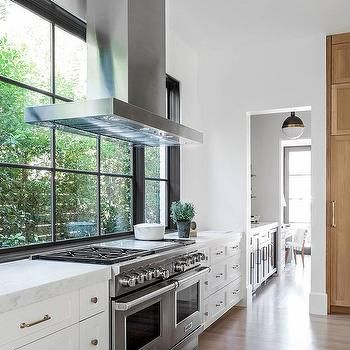 Kitchen Range Hood Placed In Front Of Windows Home Decor