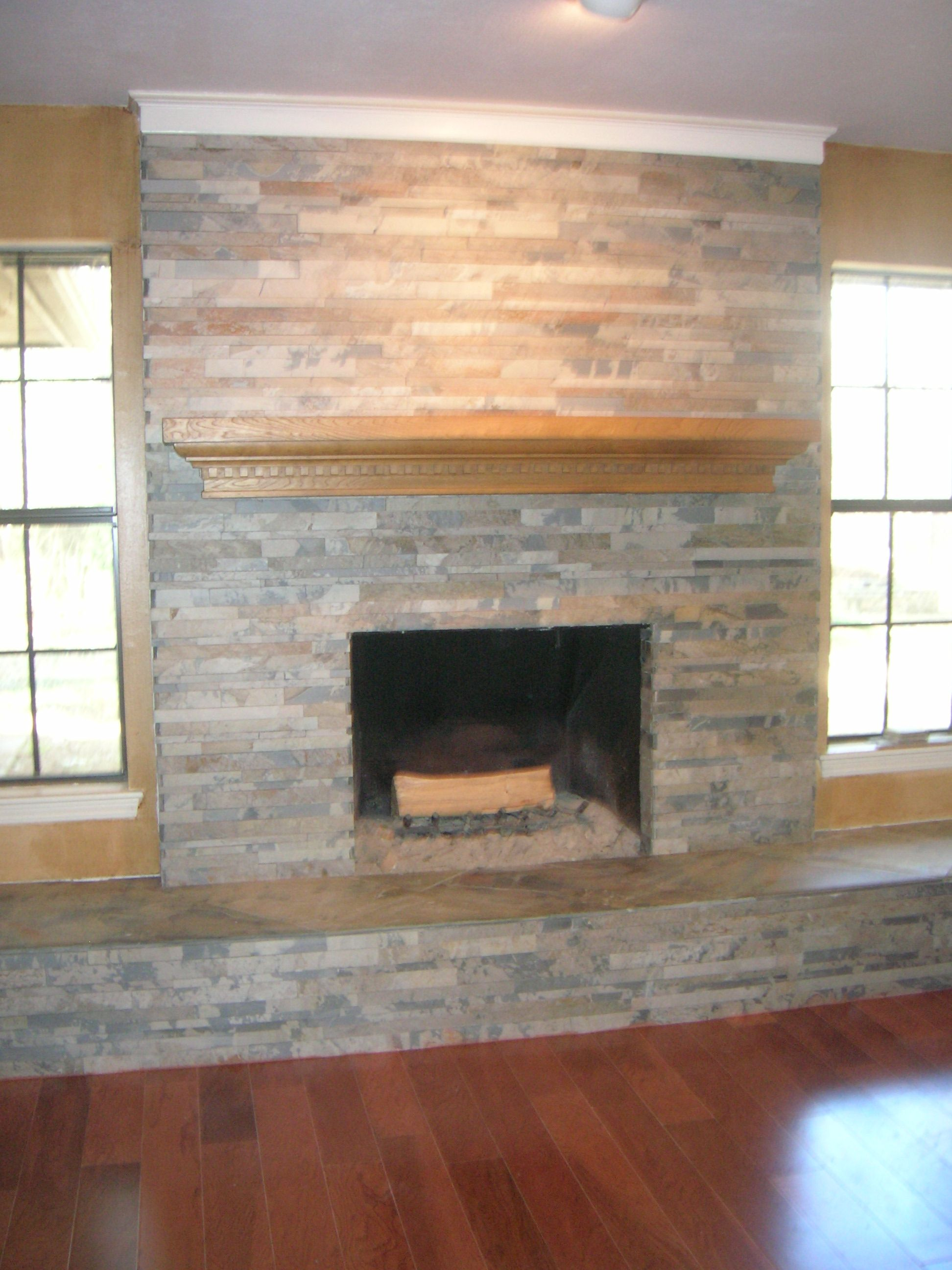 slate fireplace w linear stacked stone for a modern feel
