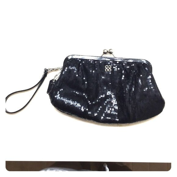 Coach black sequin wristlet, very good condition This is a like-new black sequin Coach wristlet. Bought for an occasion, and only used three times. Does have a small lipstick mark on the bottom of bag, and a small amount discoloration inside at the top where my full size wallet rubbed against it. Very good condition and perfect for special occasions! Nom-smoking home. Coach Bags Clutches & Wristlets