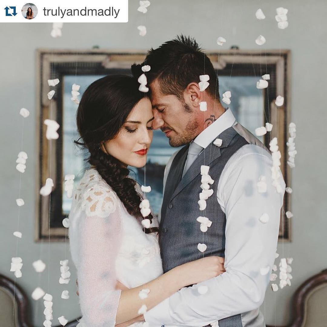 #Repost @trulyandmadly with @repostapp.  #marshmallow rain installation folks! How cool is that!? See the rest of this #classic meets #modern #styledshoot now live on #trulyandmadly: http://bit.ly/1mTDN5S  #weddingPhotographer:@catoskiphotoart Concept & #weddingdesign:@danielle_design  Concept & design:@fabilla_wedding_planner  #Flower design & #stationery:@danielle_design #weddingVenue:@lascuderiadifabilla Wedding dresses and grooms attire:@ilsognoatelier  Wedding cake and sweets…