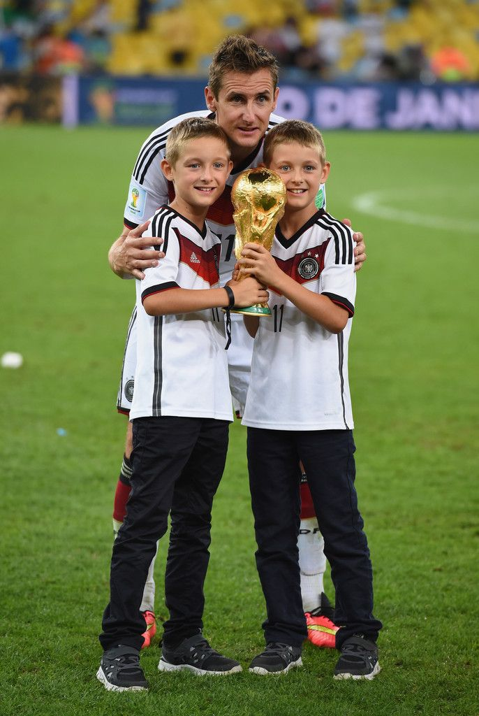 Miroslav Klose of Germany and his sons celebrate with the World Cup trophy after defeating Argentina 1-0 in extra time during the 2014 FIFA World Cup Brazil Final match between Germany and Argentina at Maracana on July 13, 2014 in Rio de Janeiro, Brazil.