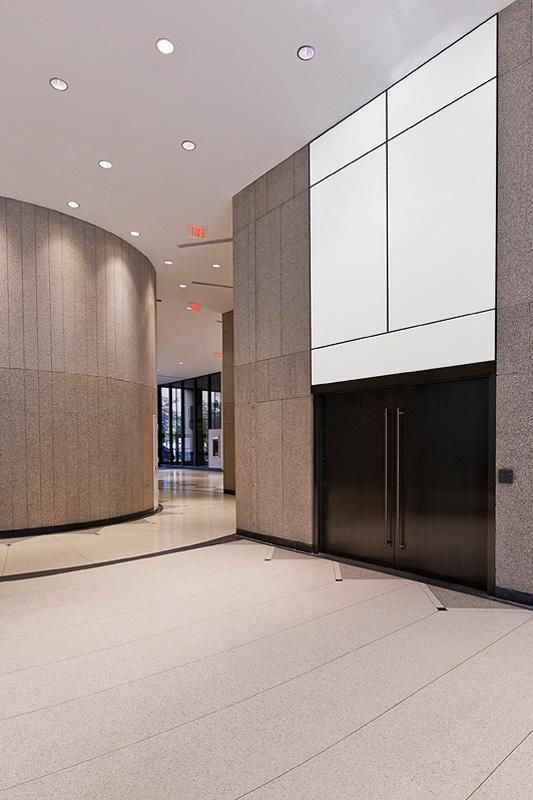 LEVELe Wall Cladding System with LightPlane Panels; insets in ViviChrome Chromis glass with White interlayer and Opalex finish shown illuminated at the Brandywine Building, Wilmington, Delaware