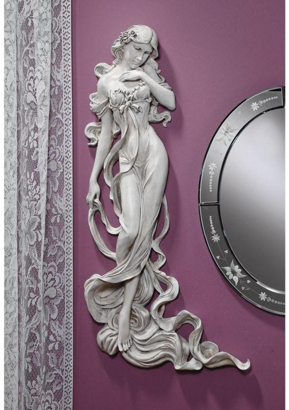 Goddess of fertility wall sculpture.