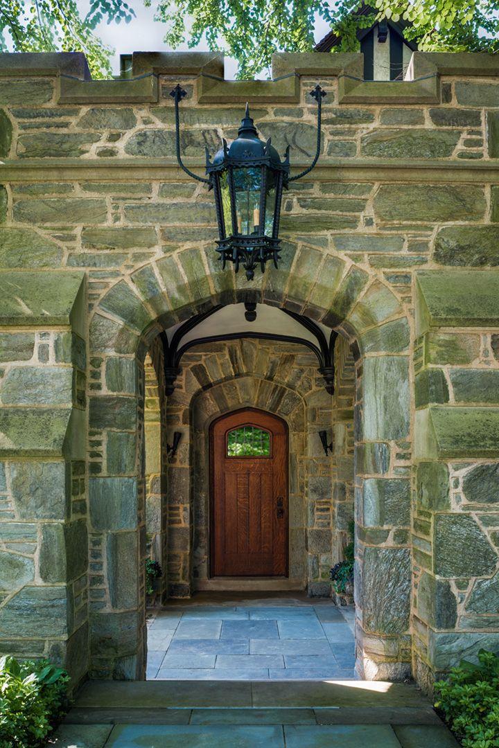 Stone Tudor House the entrance to a tudor house. the elaborate stone detail as one