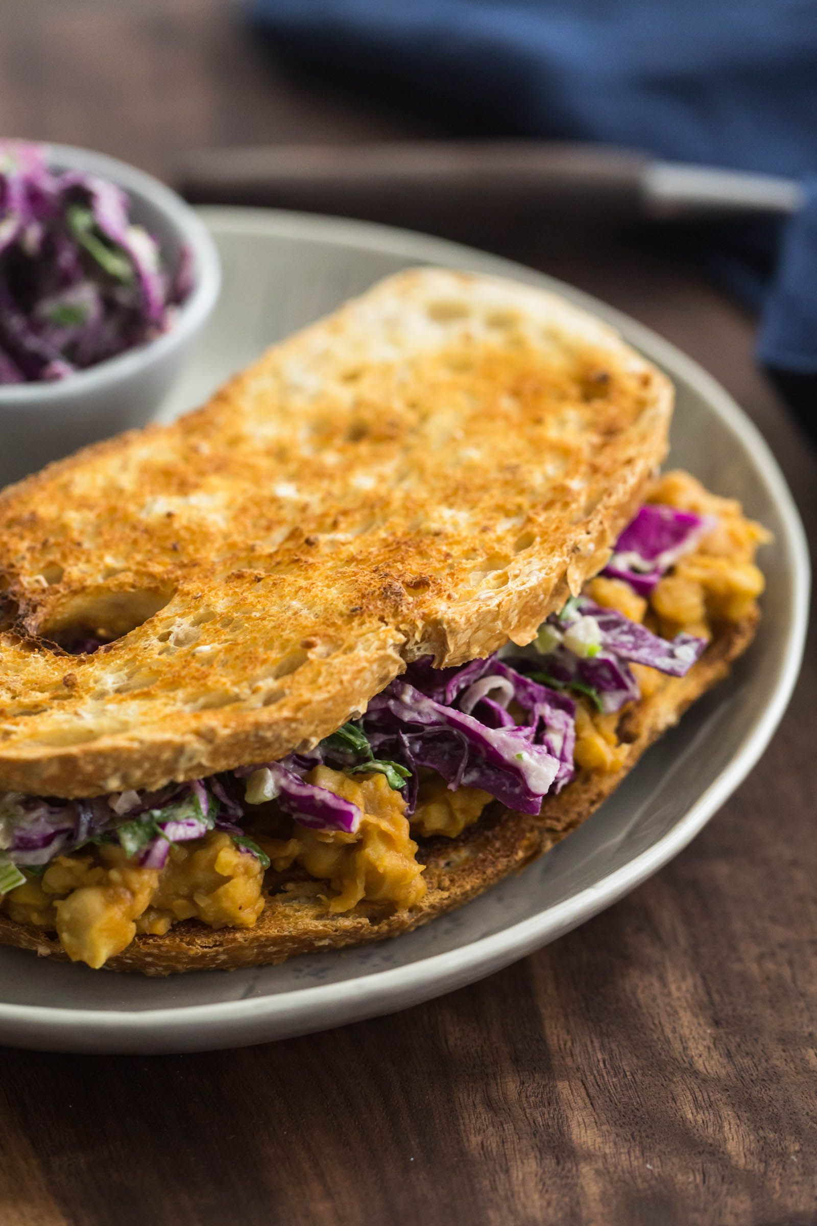 A hearty and messy meal, this bbq chickpea sandwich is made with homemade peach bbq sauce and topped with an easy tahini slaw.