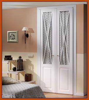 Puertas de armario con aspas y cristal closets for Puertas acristaladas interior