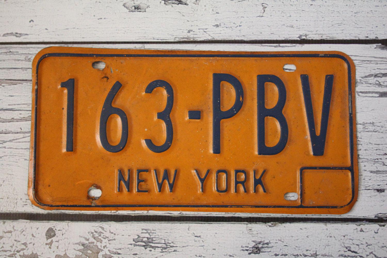 vintage new york license plate 1970s orange & blue metal sign