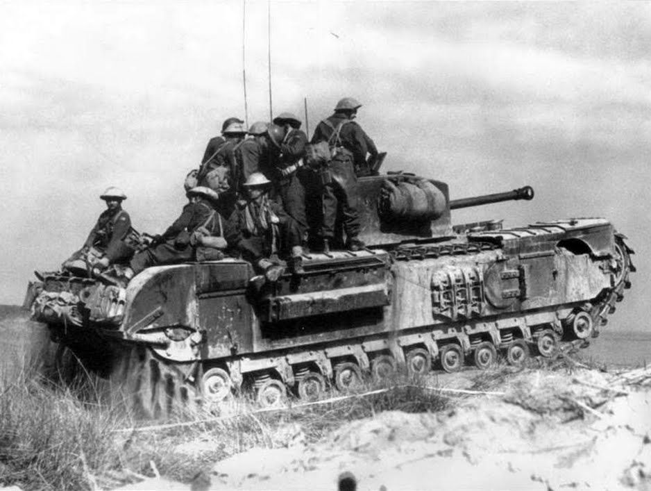 A Churchill tank in the North Irish Horse VII, carrying troops of the 21st Infantry Division, north of Castel Borsetti, the March 2, 1945.