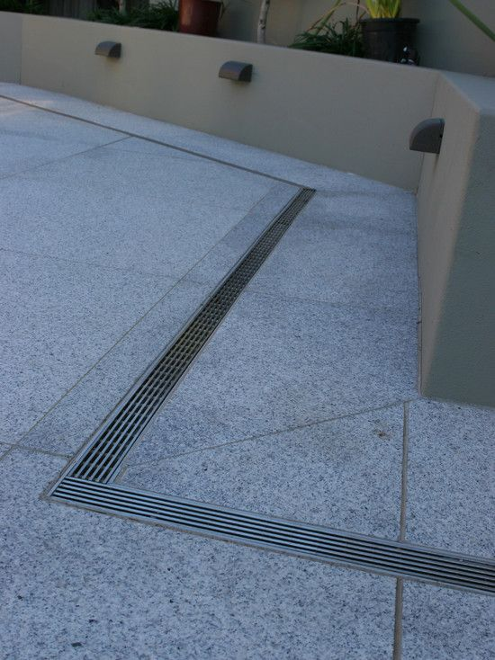Decks Patios And Balconies Concrete Patio Designs Floor Drains Paving Design