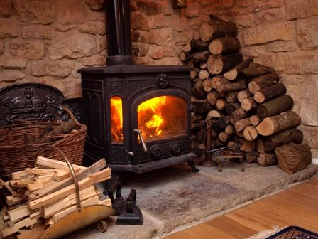 Woodburner In Large Inglenook Fireplace In Thatched Country