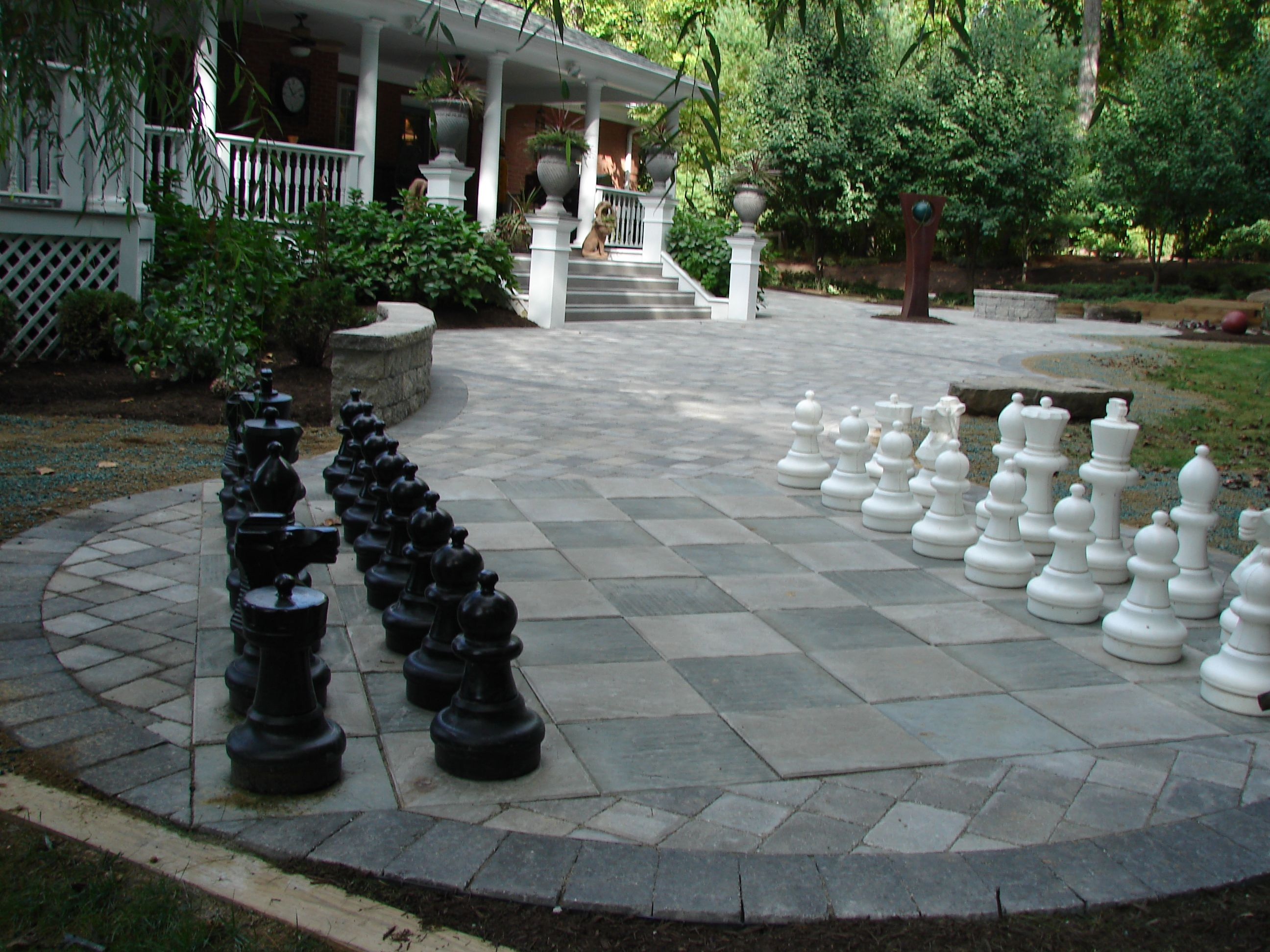 Elegant Paver Patio With Chess Set