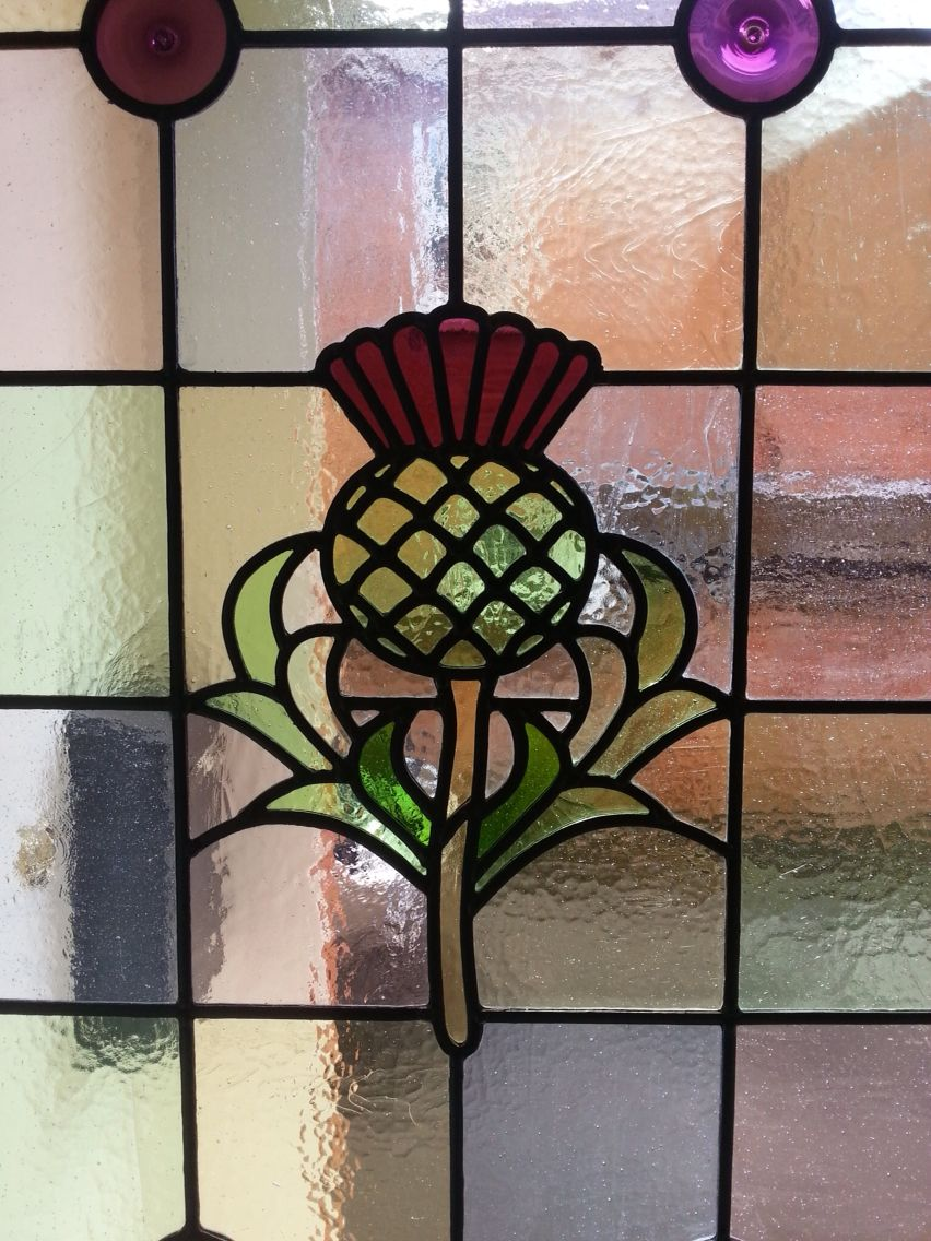 Stained glass thistle used on the side panel of a front door | Art ...