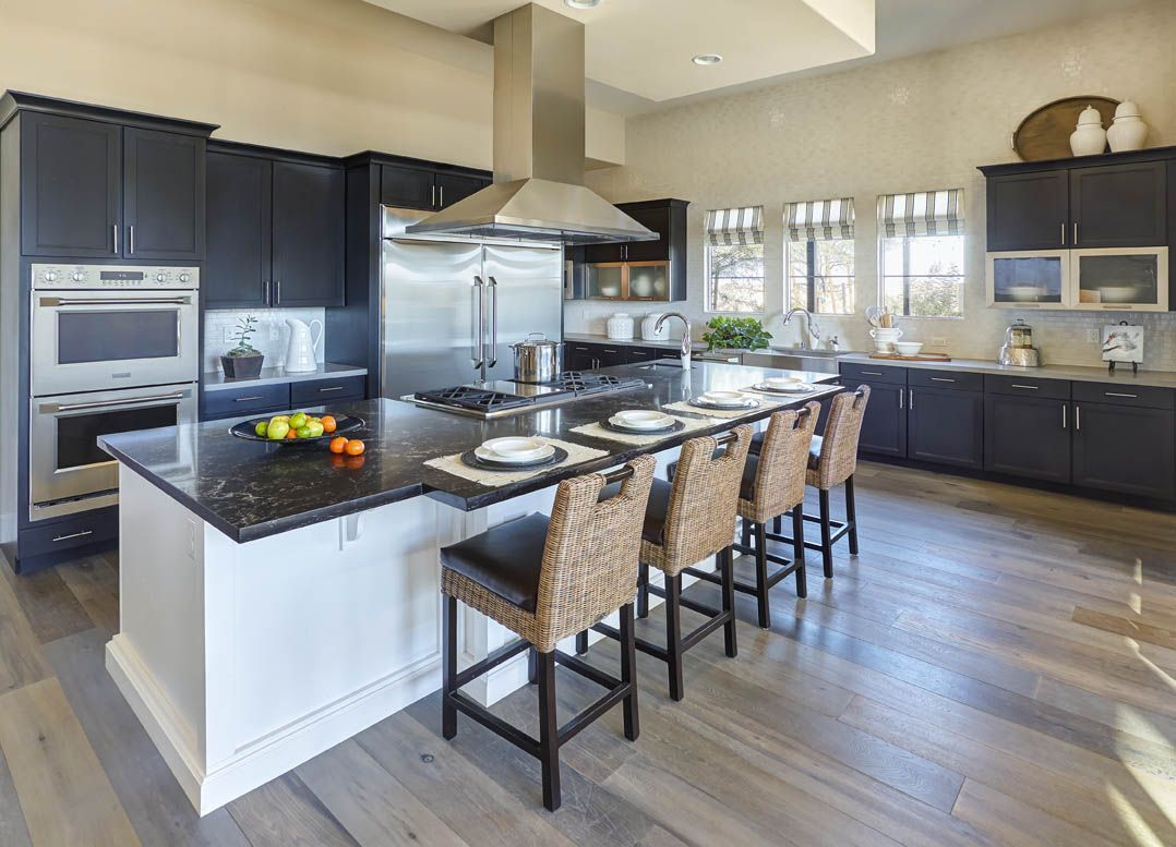 Simplistic Beauty In This Open Kitchen Norcraft Cabinetry S Mission Door Style In Maple Painted Ebony Beautifully A Kitchen Gallery Kitchen Light Wood Floors