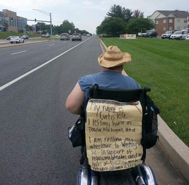 Kile, 52, drives his motorized wheelchair Friday in Maryland as he rides to Washington, D.C., hoping to tell President Barack Obama about the concerns of those using medical marijuana. www.SativaMagazine.com #SativaMagazine