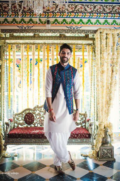 Mehendi groom wear kurta with blue jaipuri jacket