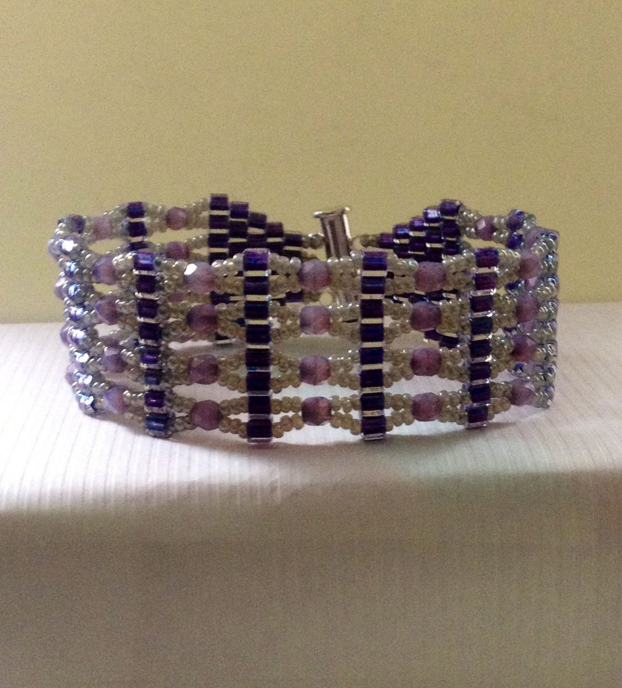Purple Imperial bracelet...a Potomac Bead Company design...3mm cube, 4mm Czech  fire. Polished beads and 11/0 seed beads.  Item#:  130825-BR-001