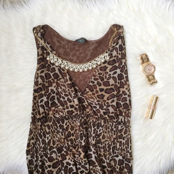 Beautiful Leopard Cheetah Printed Dress Beautiful Leopard Cheetah Printed Dress. Amazing color & rich tons! This is a midi dress not a maxi. Nice warm color for the spring and summer. Such  a staple! Size XL. New with tags! BCBGMaxAzria Dresses Midi