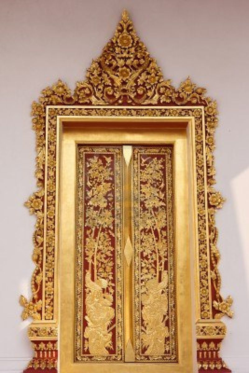Golden arch and ancient doors of buddhist temple antique doors and