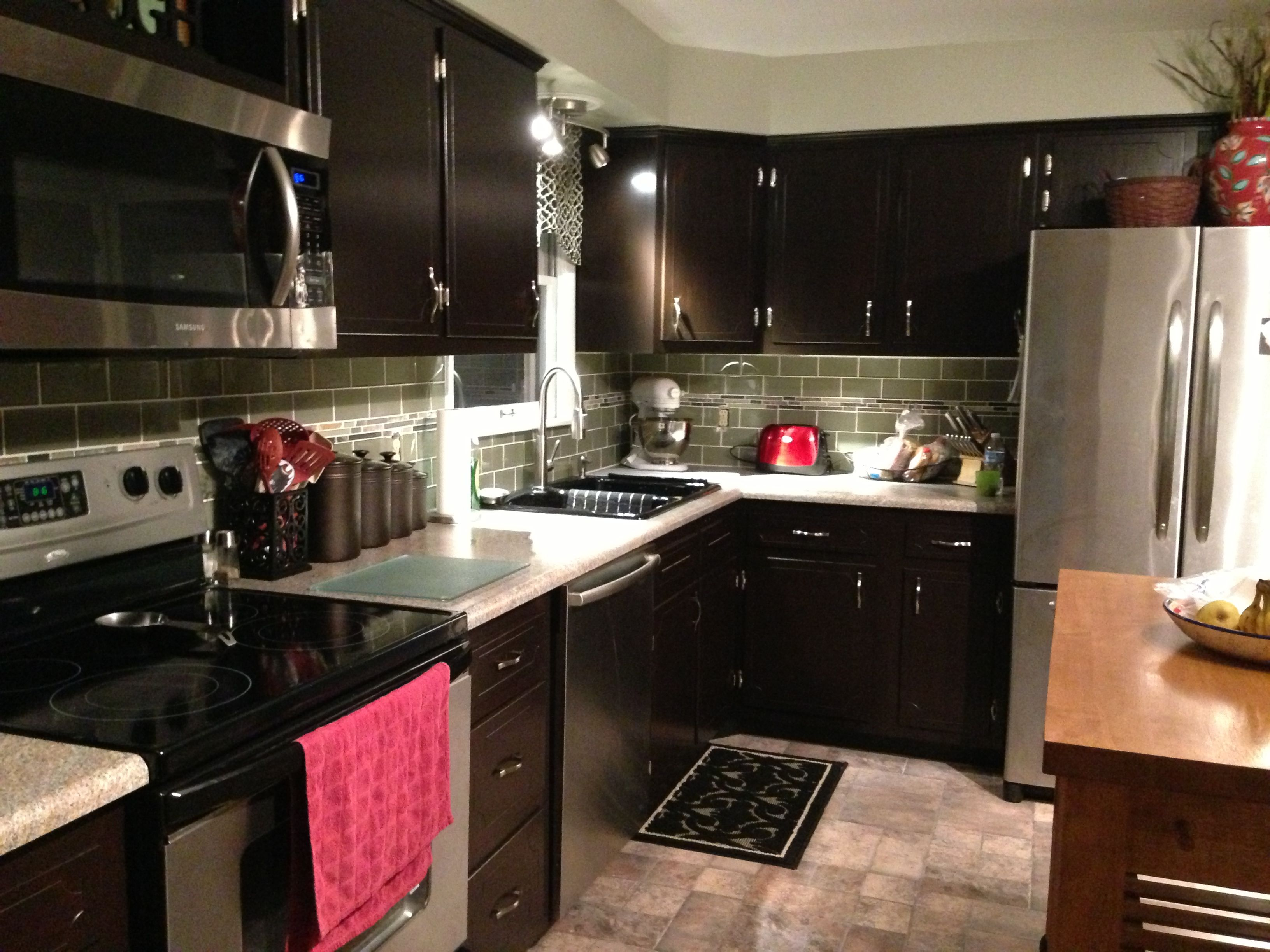Kitchen Remodel Java Gel Stain Cabinets Backsplash Glass Subway Tile With Glass Mosiac Strip Kitchen Remodel Kitchen Renovation Kitchen Inspirations