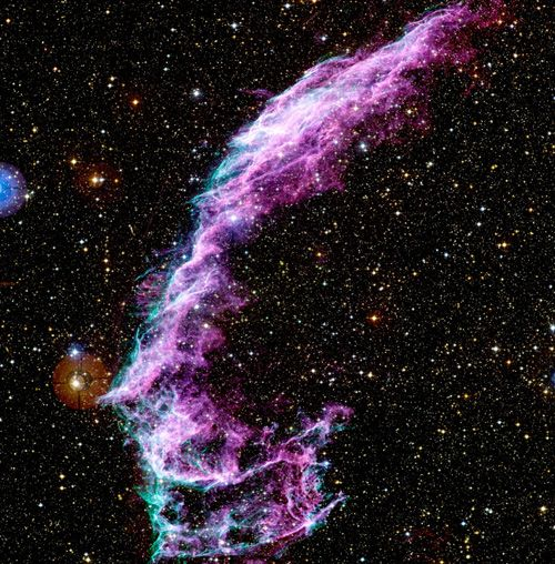 This image shows a small part of the Veil Nebula, the remains of a supernova, an immense stellar explosion, that happened between 5000 and 8000 years ago. Here we can see the interstellar gas being heated by the incredible shockwave that is still expanding through space at around 170 kilometres per second.    Credit: Image made in visible light by Jean-Charlies Cuillandre for the Canada-France-Hawaii Telescope Corporation.