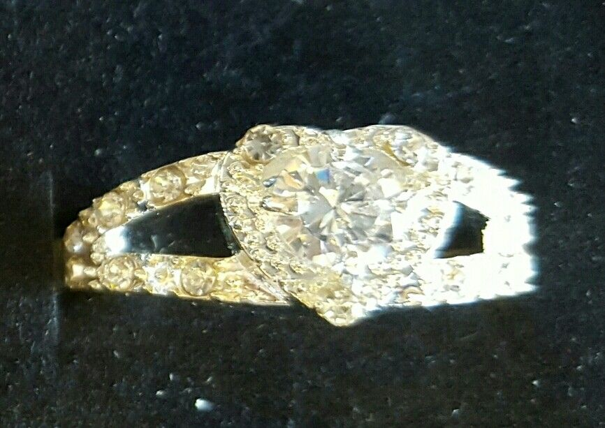 Size 7 Sterling Silver and White Sapphire  $25.00.  815-529-2263