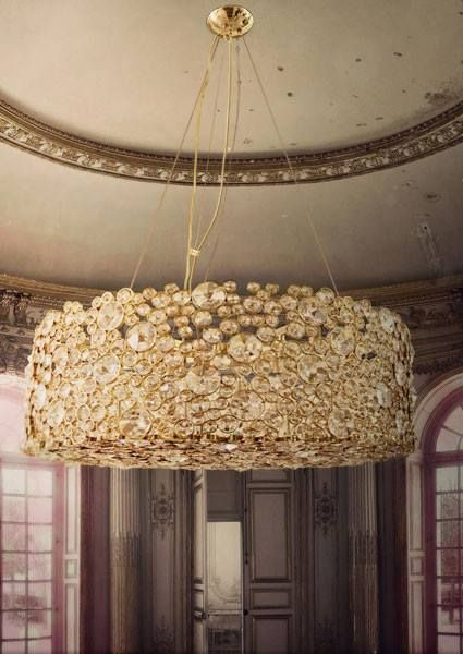 The eternity chandelier by koket is the epitome of illuminated extravagance this chic light fixture attributes diverse sized crystals each and every