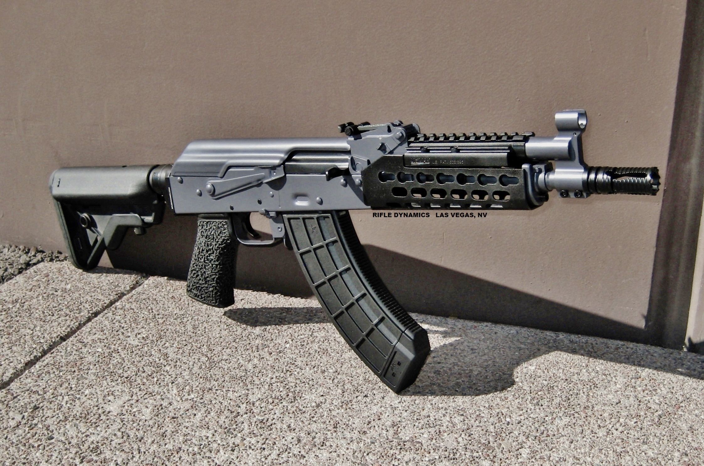 """Rifle Dynamics / Here is the RD710 (7.62x39) SBR, complete with paint job in grey moly. The 10"""" barrel greatly improves velocity. Full length handguards (modified Krebs Keymod shown here), Ultimak rail, Fuller rear sight, M-4 stock adapter with B-5 System Bravo stock, and US Palm grip. Awesome!"""