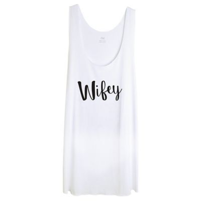 Show off your non-single status in a Wifey Tank Top! Made of polyester and rayon this white tank top is comfortable and features a relaxed fit. In the middle a large Wifey headline is printed in a black cursive font. Wear this tank top during your honeymoon or give it as a gift to the new wife in your life.  Wifey Tank Top product details:  65% polyester and 35% rayon One size fits most Hand wash cold dry flat