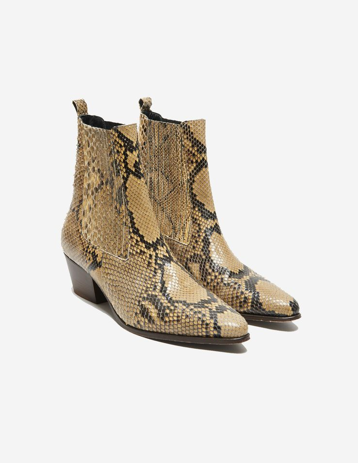 7ab62b92695e8 Sandro cowboy boots in python. Pointed toe and contrasting-colour heel.  These luxurious boots will add a stylish and edgy look to your outfit. 4 cm  heel.