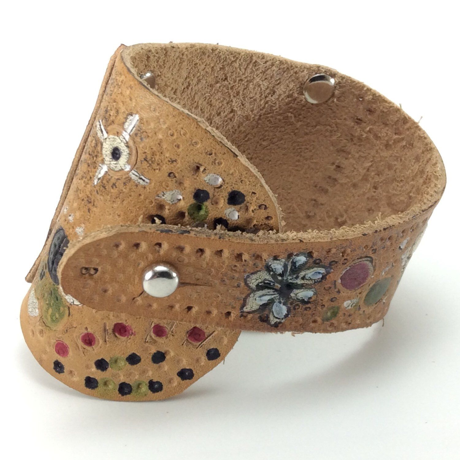 A personal favorite from my Etsy shop https://www.etsy.com/listing/269595176/leather-cuff-hand-tooled-and-painted