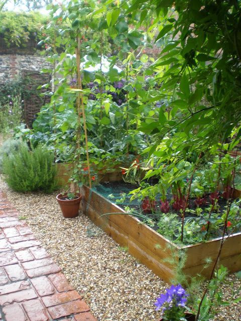 Brick and pea gravel in this potager garden | Outdoor ...
