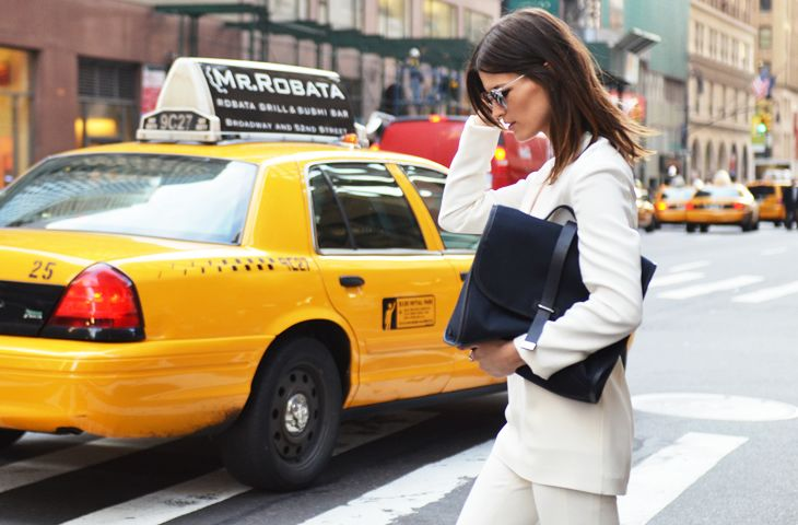 The chicest of chic white suits + dark hair + black bag = love.