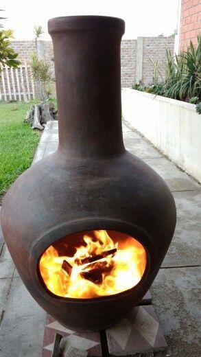 Una chimenea de barro chimeneas estufas pinterest - Chimeneas de barro ...
