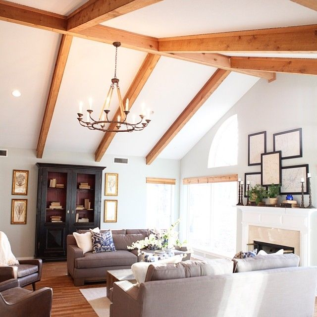 One of my favorite living rooms from season one #fixerupper  The beams and the chandelier @ballarddesigns gave this dated farmhouse a fresh look!
