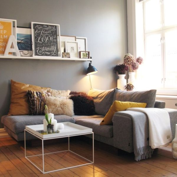 Lots of pillows..yellow..fuzzy white..etc.. adds a cozy comfy look to couch