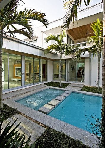 Pool In The Courtyard Of A U Shaped House The Stepping Stones Offer A Path Through The Courtyard While Also Divid Small Backyard Pools Cheap Pool Modern Pools