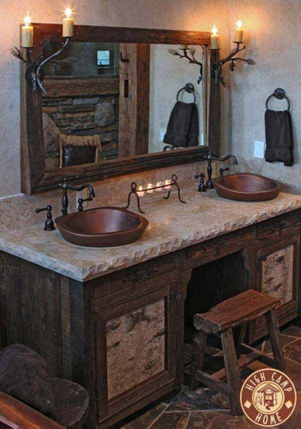 Very Rustic Bathroom. The Stone Countertops With The Wooden Cupboards Give  The Room The Rustic Style! The Copper Metal Sinks Give The Room A Nice  Touch.