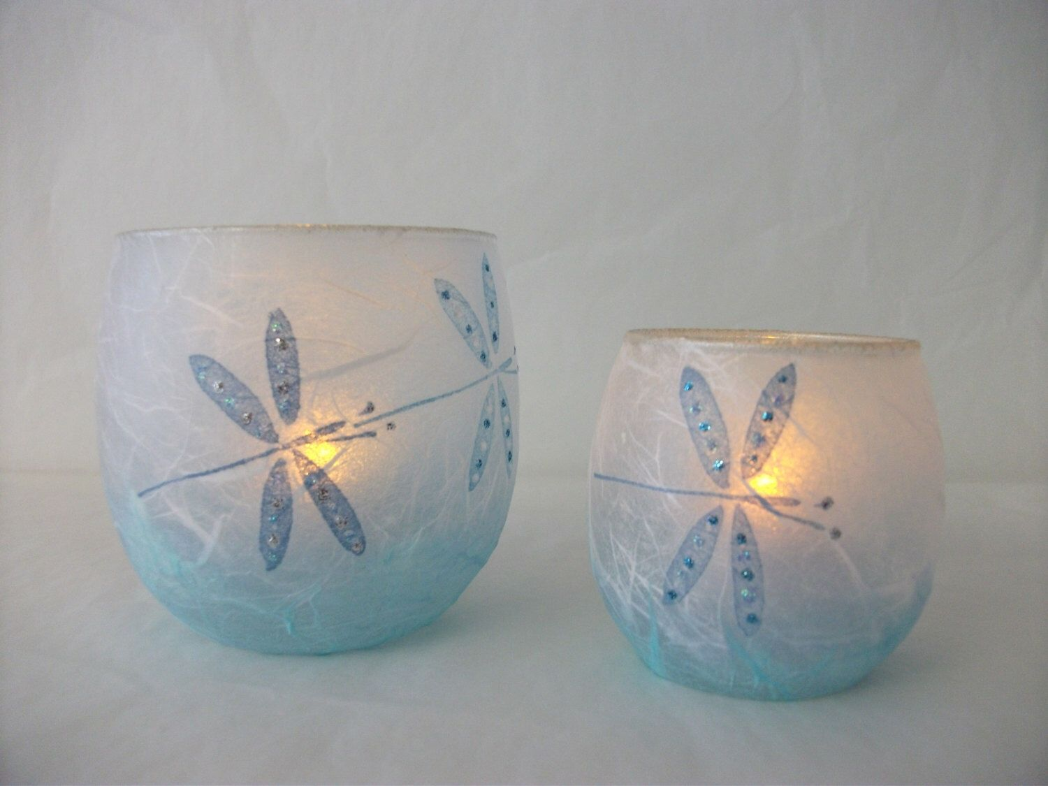 Dragonfly Tea Light Candle Holder Set in shades of Blue.New home gift/mothers day gift. by TheGlasscraftstudio on Etsy https://www.etsy.com/listing/201362438/dragonfly-tea-light-candle-holder-set-in