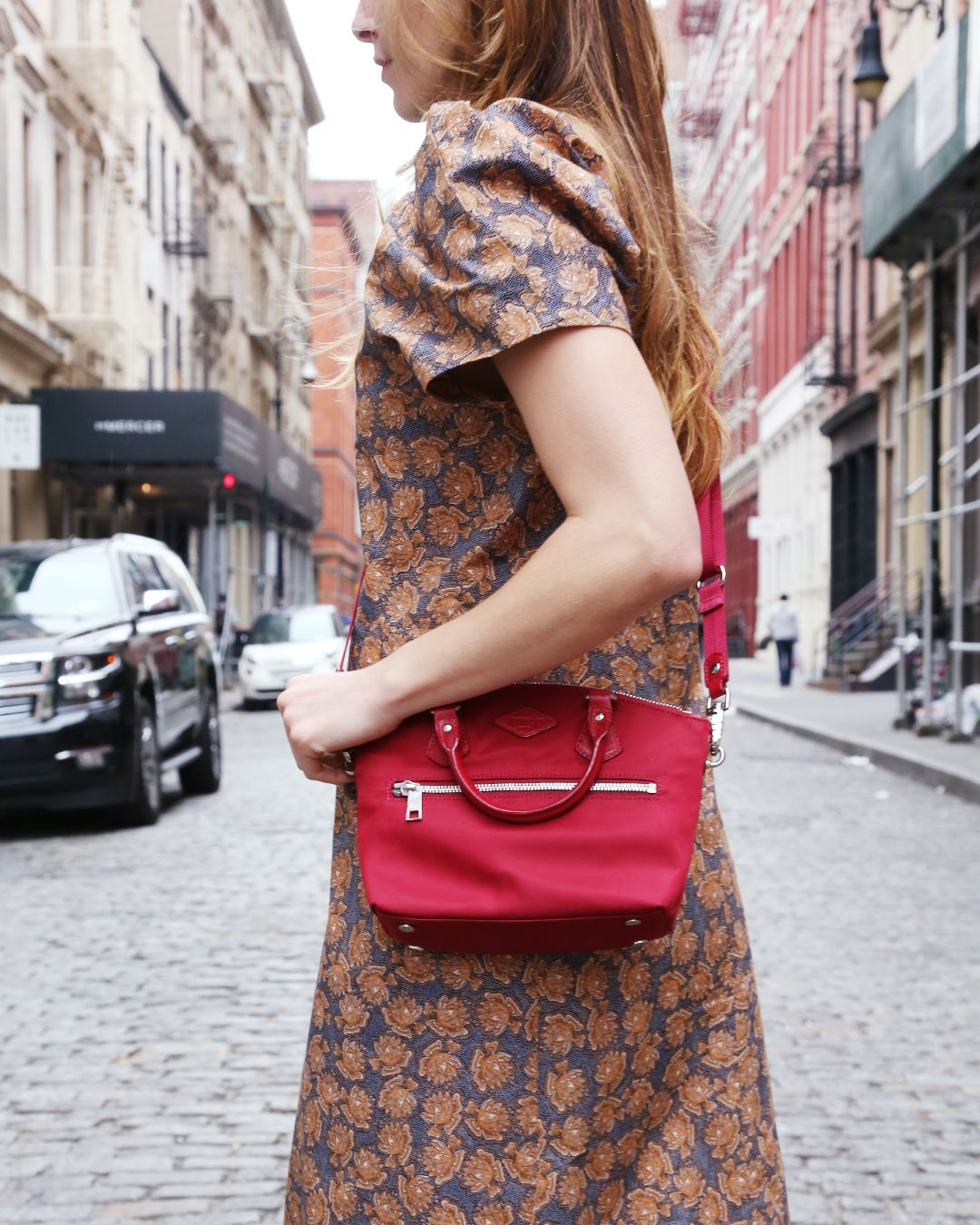 98cb33cc73da The MZ Wallace Mini Chelsea Tote worn as a crossbody on Crosby Street.