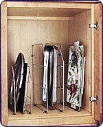 "18"" High Tray Divider Organizer, Chrome by Rev-A-Shelf. $8.32. 18"" High. 20"" Deep. 3/4"" Wide. Chrome Finish. The Tray Dividers are perfect for organizing larger trays like: cookie sheets, bakeware, pizza pans, muffin pans, cutting boards, splatter guards, serving trays, etc.,  into smaller compartments for easier access.The dividers come standard with mounting clips, for upper pantry or base cabinet applications. Priced each."