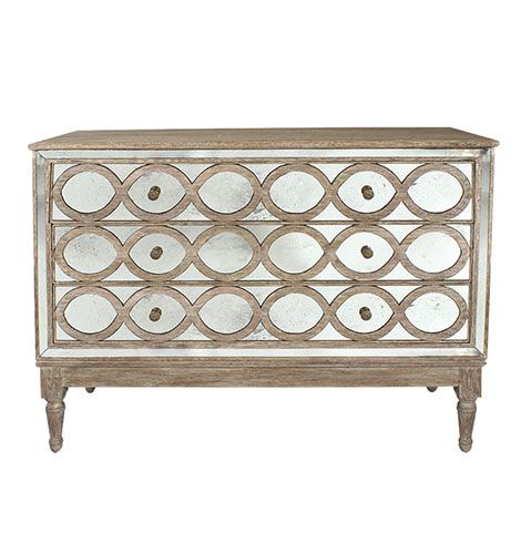 The Ogee commode is finished in handcrafted, rustic aged wood. With intricate circular moldings and dramatic antiqued mirror panels, this dresser carries a vintage, timeworn appeal. Drawers on wood rail slides.