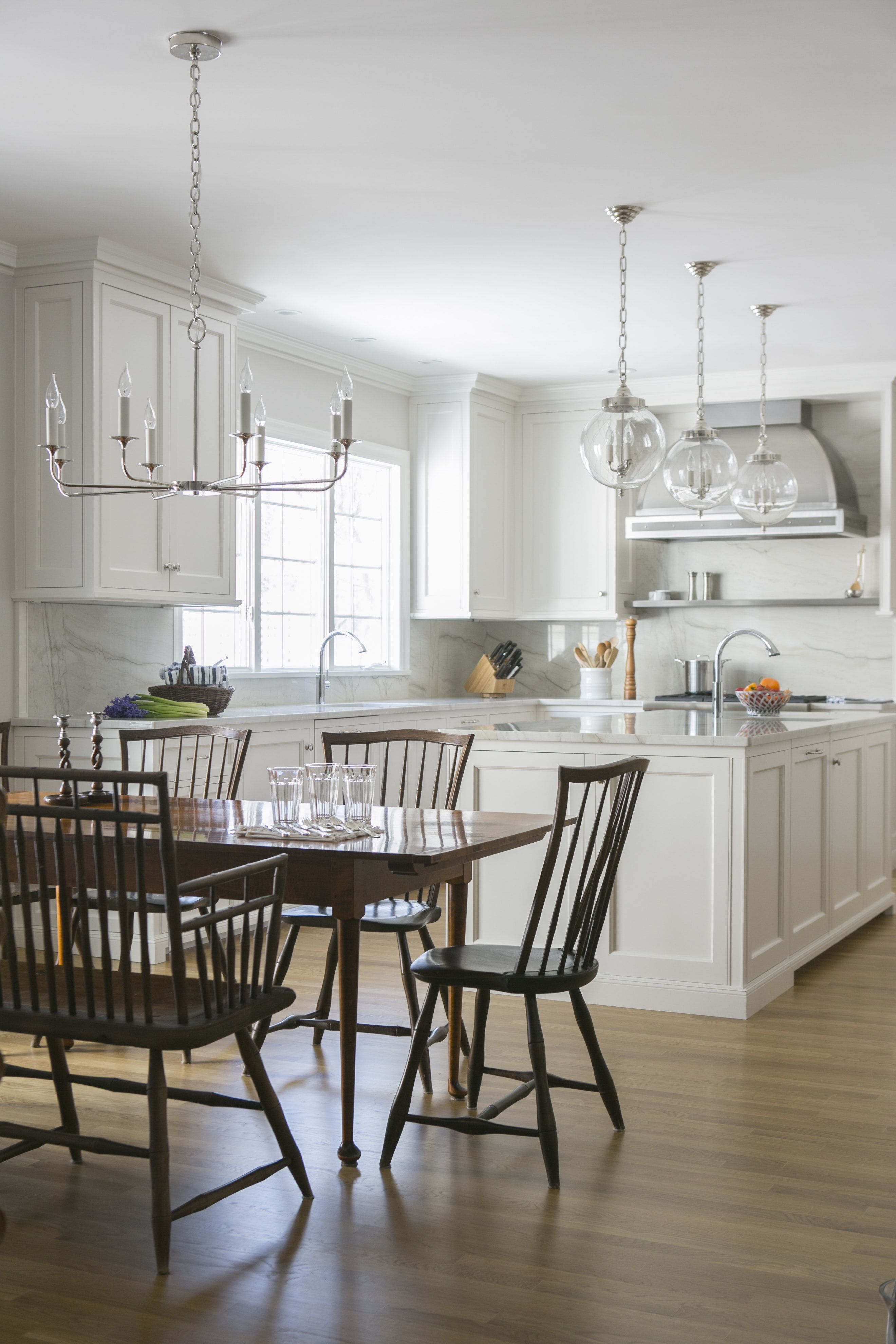 Antique Dining Chairs And Dining Table In Contrast To The Classic White Kitchen Open Dining Room Classic White Kitchen Kitchen Dining Room