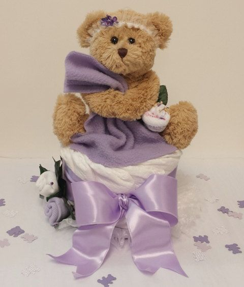 This Lavender Baby Shower Centerpiece With Its Blankie Bear Teddy Bear  Sitting On A Diaper Cake