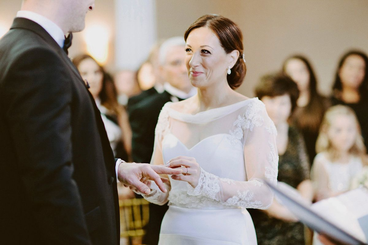 A longsleeved suzanne neville gown for a black tie winter wedding